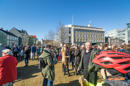 REYKJAVIK, ICELAND - APRIL 9 - 2016: People in Iceland at the main square, protesting against the government of Iceland