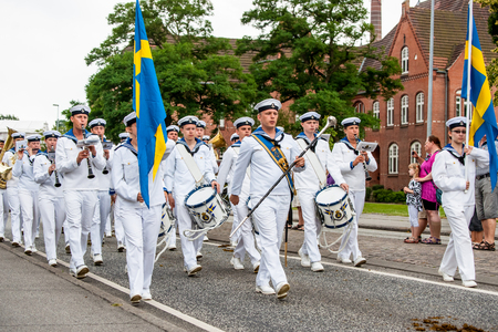 tilting: AABENRAA, DENMARK - JULY 6 - 2014: Swedish tambour corps at a parade at the annual tilting festival in Aabenraa