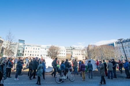 law of panama: REYKJAVIK, ICELAND - APRIL 9 - 2016: Crowd protesting against the government of Iceland during the Panama paper scandal