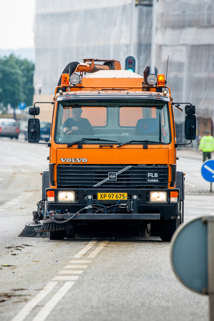 tilting: AABENRAA, DENMARK - JULY 6 - 2014: Sweeper cleaning the streets at the annual tilting festival in Aabenraa