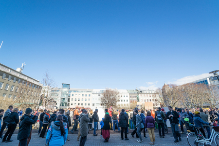 REYKJAVIK, ICELAND - APRIL 9 - 2016: Crowd at the main square in Reykjavik, demonstrating against the government of Iceland