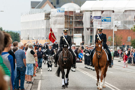 tilting: AABENRAA, DENMARK - JULY 6 - 2014: Police escort at a parade at the annual tilting festival in Aabenraa