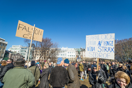 scandal: REYKJAVIK, ICELAND - APRIL 9 - 2016: Crowd demonstrating against the government of Iceland during the Panama paper scandal