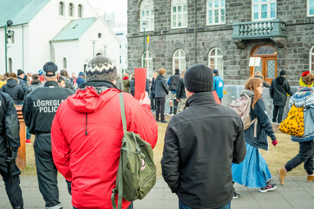 REYKJAVIK, ICELAND - APRIL 7 - 2016: Man showing a red card at a demonstration against the government of Iceland during the Panama paper scandal Editorial