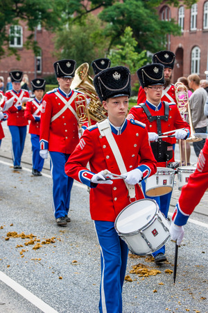 tilting: AABENRAA, DENMARK - JULY 6 - 2014: Tambour corps at a parade at the annual tilting festival in Aabenraa