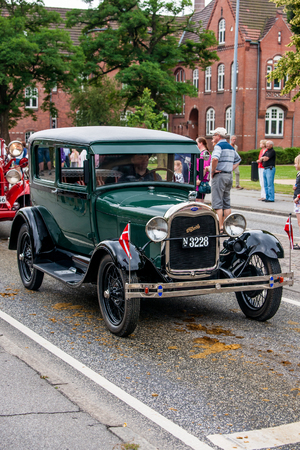 tilting: AABENRAA, DENMARK - JULY 6 - 2014: Veteran car at a parade at the annual tilting festival in Aabenraa