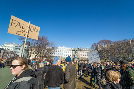 REYKJAVIK, ICELAND - APRIL 9 - 2016: People with sign demonstrating against the government of Iceland