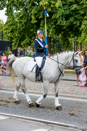 tilting: AABENRAA, DENMARK - JULY 6 - 2014: Participating riders in a parade at the annual tilting festival in Aabenraa