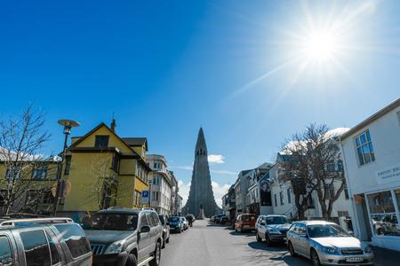 erikson: REYKJAVIK, ICELAND - APRIL 7 - 2016: Street in Reykjavik with the Hallgrimskirkja at the end