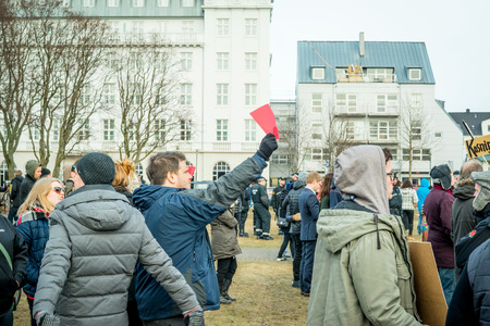 scandal: REYKJAVIK, ICELAND - APRIL 7 - 2016: People protesting against the government of Iceland during the Panama paper scandal Editorial
