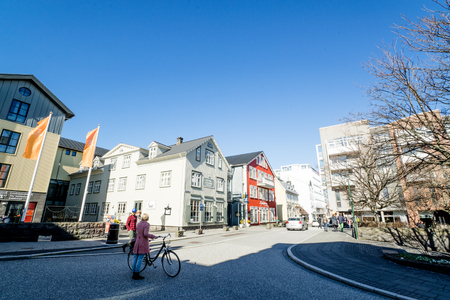 Reykjavik: REYKJAVIK, ICELAND - APRIL 9 - 2016: Early morning in Reykjavik with people in the streets Editorial