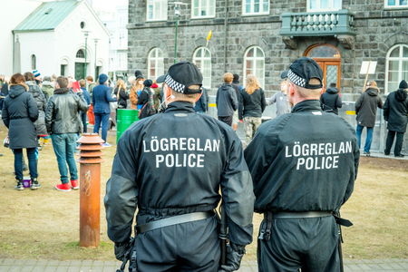 scandal: REYKJAVIK, ICELAND - APRIL 7 - 2016: Police at a demonstration against the government of Iceland during the Panama paper scandal