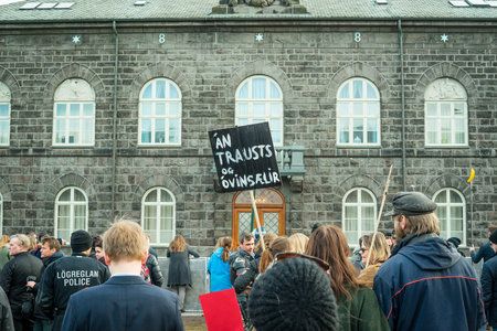 REYKJAVIK, ICELAND - APRIL 7 - 2016: People demonstrating outside the government of Iceland during the Panama paper scandal Editorial