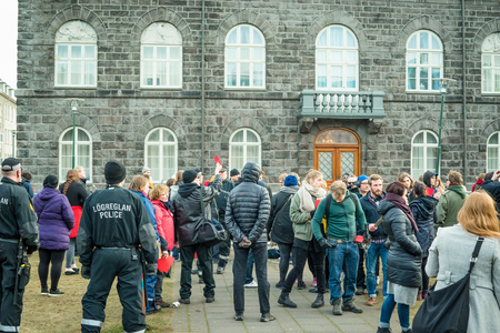 REYKJAVIK, ICELAND - APRIL 7 - 2016: People at a public demonstration against the government of Iceland during the Panama paper scandal Editorial