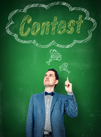 Man in elegant clothes thinking of winning a contest Stock Photo