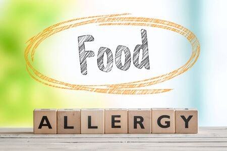 food allergy: Food allergy sign on a table with a nature background