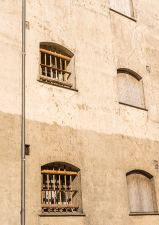 iron barred: Bars on prison windows on a conrete wall