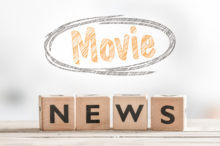 livestream: Movie news sign cubes on a table with a sketch Stock Photo