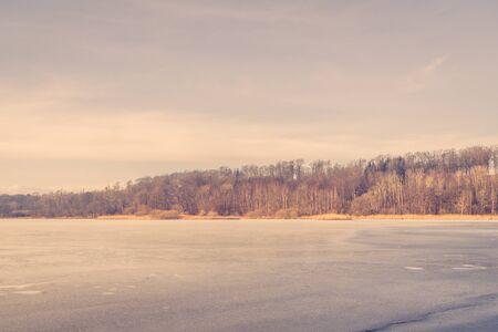 january sunrise: Frozen lake in Scandinavia in the winter