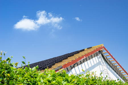 roofing membrane: Roof renovation with black tiles in the summer Stock Photo