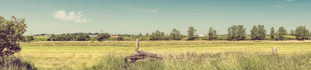 fencepost: Rural western landscape in the summer in panorama