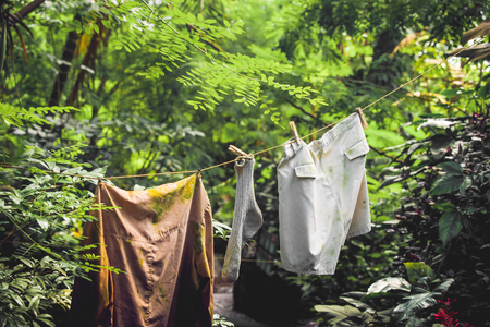 laundry line: Dirty laundry on a wire in a jungle Stock Photo