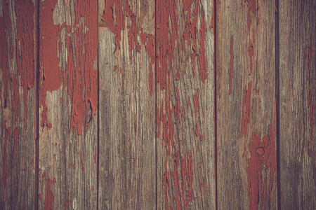 pealing: Red paint pealing off old wooden planks