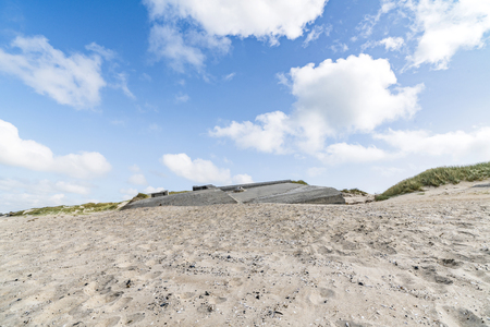 German bunkers burried in a sand dune on a beach by the northern sea in Denmark