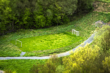 Small football pitch in a park seen from above with two goals surround by trees Stock Photo