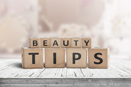 Beauty tips sign on a makeup table in a bright powder room with a pink tone