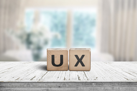UX development sign on a table in a bright room with cyan colors 版權商用圖片