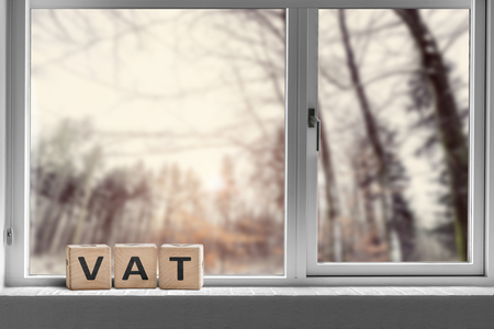 VAT sign on a window sill in the morning sunrise on a bright day 写真素材