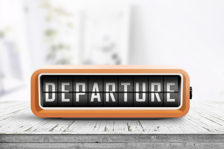 Departure sign in a retro alarm clock showing that it is time to go