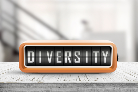Diversity word on a retro device on a wooden table in a bright office building Banco de Imagens