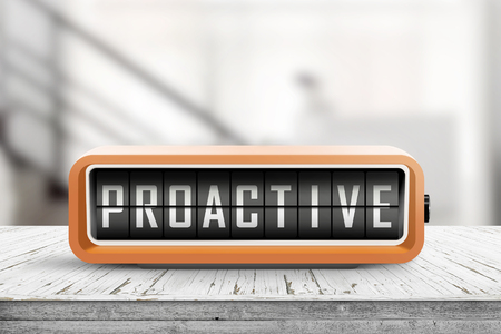 Proactive sign in the shape of a retro device on a wooden desk in a room Stockfoto