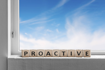 Proactive sign in a window sill on a bright day with a blue sky outside