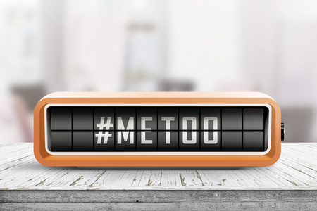 Metoo hashtag message on a retro alarm device in a bright room on a table Stok Fotoğraf