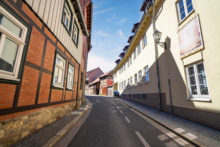 City street in Germany with old bavarian houses in the summer under a blue sky
