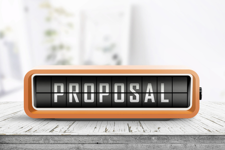 Proposal message on an alarm device in a living room with bright daylight