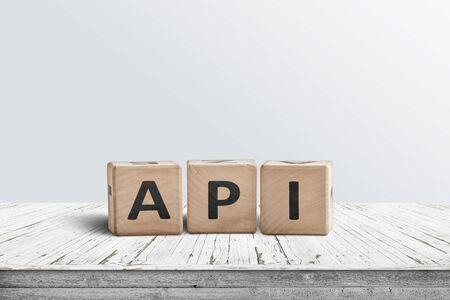 API app programming sign made of wooden blocks on a white desk