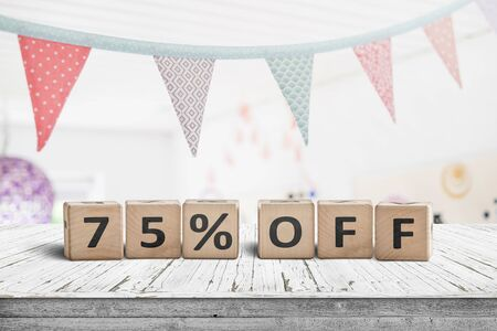 Special price 75 percent off promotion sign on a desk with colorful flags above