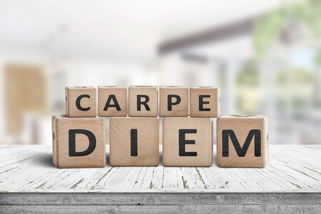 Carpe diem seize the day sign on a table in a bright home environment