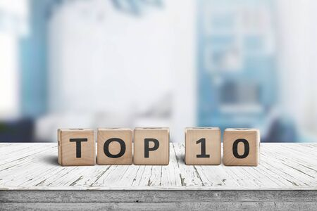 Top 10 sign made of wooden dices on a table i a bright environment with blue colors