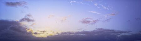 Beautiful panorama sunset in violet colors on a cloudy evening