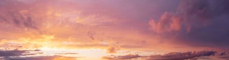 Panorama sunset with dramatic clouds in violet and orande colors
