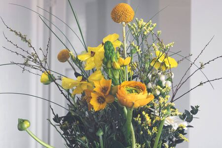 Colorful Easter decoration with flowers in yellow and green colors