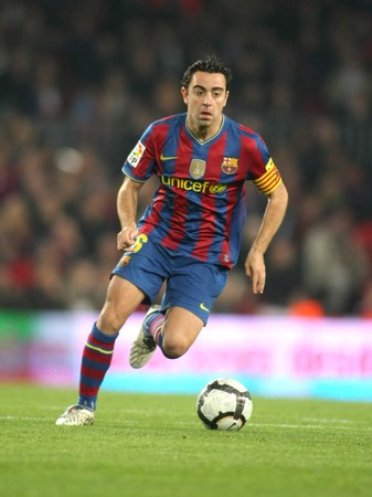 Xavi Hernandez of Barcelona in action during a Spanish League match between FC Barcelona and RC Deportivo at the Nou Camp Stadium on April 14, 2010 in Barcelona, Spain Editorial