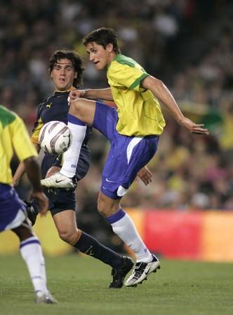 Brazilian player Edmilson in action during the friendly match between Catalonia vs Brazil at Nou Camp Stadium in Barcelona, Spain. May 25, 2004