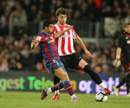 Pedro of Barcelona and Amorebieta of Bilbao in action during a Spanish League match between FC Barcelona and Athletic Bilbao at the Nou Camp Stadium on April 3, 2010 in Barcelona, Spain