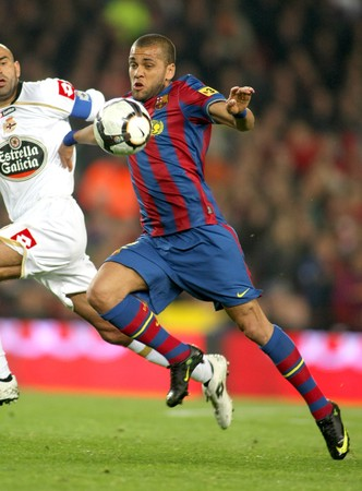 Dani Alves of Barcelona in action during a Spanish League match between FC Barcelona and RC Deportivo at the Nou Camp Stadium on April 14, 2010 in Barcelona, Spain